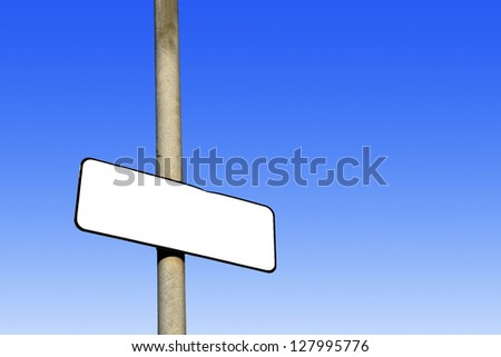 Blank white sign against a graduated blue background