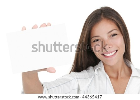 Blank white sign card. Young businesswoman holding white business card / empty paper sign with a lot of copy space. Beautiful mixed race chinese / caucasian woman isolated on seamless white background
