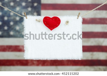Blank White Sign With Red Heart Hanging On Rope Clothesline In Front Of Antique Rustic American