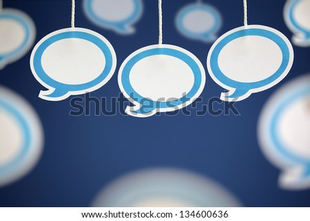 Blank white speech bubbles hanging from string