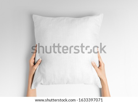 Blank white square pillow mockup holding with two hands by woman ストックフォト ©