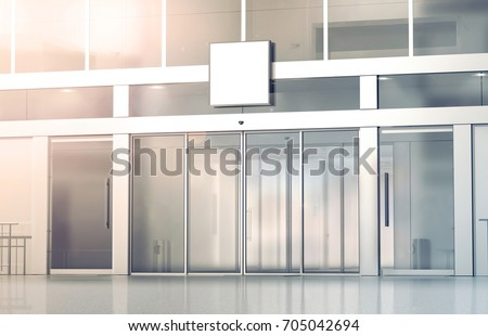 Blank white square signage mockup on the store glass sliding doors entrance, 3d rendering. Commercial building automatic entry, banner mock up. Closed transparent business centre facade, front view.