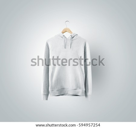 Blank white sweatshirt mockup hanging on wooden hanger. Empty sweat shirt mock up on rack isolated. Clear cotton hoody template. Plain textile hoodie design presentation. Loose overall casual jumper.