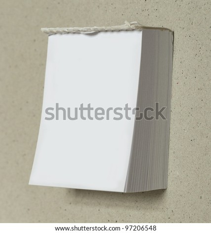 "blank white ""tear off"" calendar with room for your text on a cardboard background"