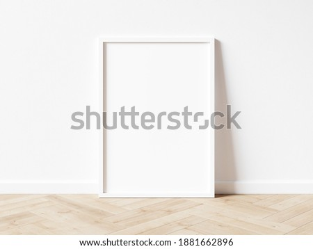 Blank white vertically oriented rectangular exhibition background standing on wooden parquet floor leaning on white wall. 3D illustration.