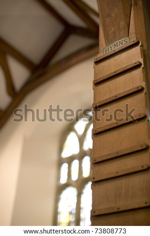 blank wooden hymn board in a gothic style church - stock photo