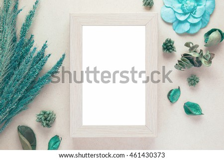 Blank wooden photo frame and dried flowers valentines day with vintage filter color