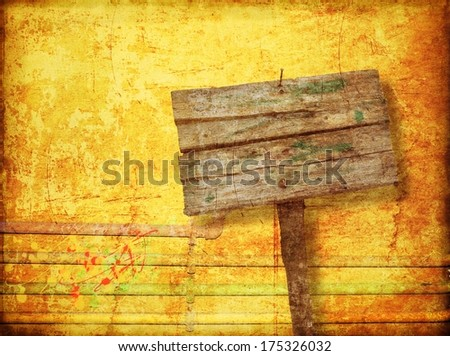 Blank wooden sign on yellow wall