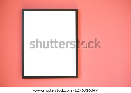 Blank wooden square photo frame modern interior design decorated on Living Coral  wall background with copy space for text or image. Famingo concept