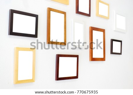 81422aa65b17 Blank wooden square photo frame modern interior design decorated on white  wall background with copy space