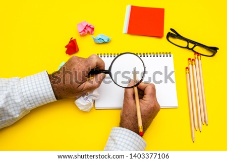 Blank writing pad for ideas and inspiration on colored background.