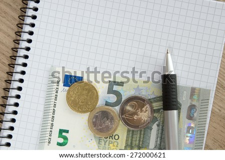 Blank writing pad with a pen and euro money / writing pad