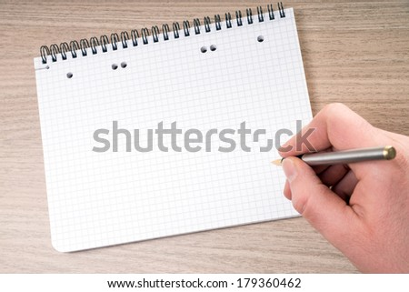 blank writing pad with hand and pen / blank writing pad