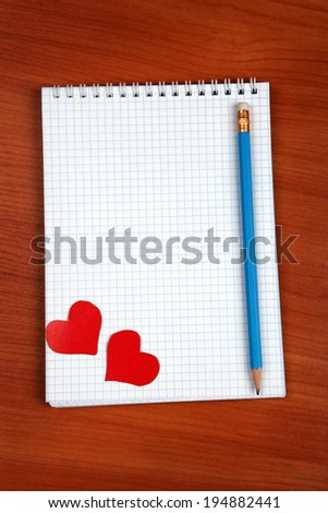 Blank Writing Pad with Heart Shapes and Pencil On The Table
