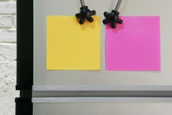 Blank Yellow, Pink Paper Notes Sticked on Refridgerator Door for Add Text Message