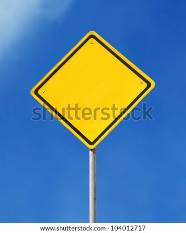 Blank yellow road sign on sky background