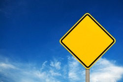 Blank yellow road sign or Empty traffic signs on the blue sky background