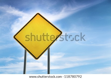 Blank, Yellow Road Warning Sign and blue sky behind