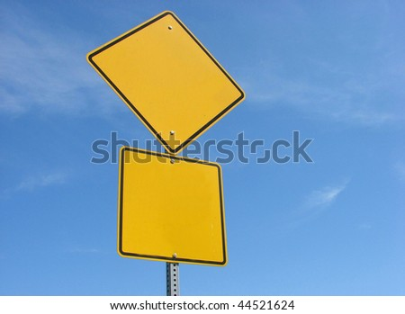 blank yellow sign with blue sky