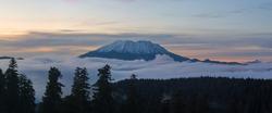 Blanket of fog rolling below Mount Saint Helens during sunset panorama