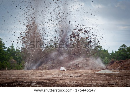 Blasting limestone rock so it can be excavated for the limstone industry.GN
