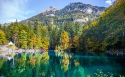 Blausee/ Blue Lake nature park in early fall, Kandersteg, Switzerland