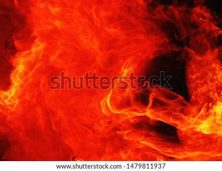 blaze fire flame texture background. background of fire as a symbol of hell and eternal torment