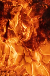 Blaze red fire natural background. Dangerous firestorm abstract texture. Atmospheric dispersion, defocus (soft focus), motion blur from fire, high temperature from flames.