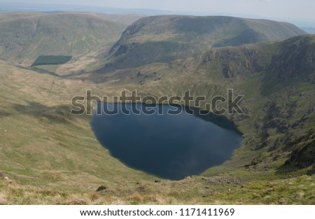 Blea Water, a Glacially Excavated Tarn or Corrie, in the Mardale Valley by Haweswater Reservoir within the Lake District National Park, Cumbria, England, UK