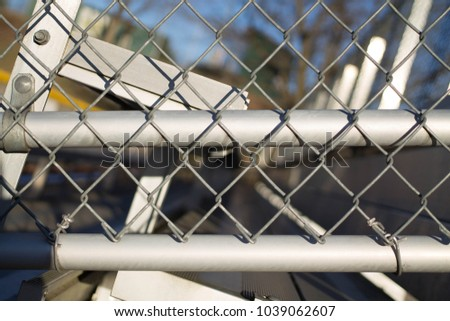 bleachers at park with chain link sides