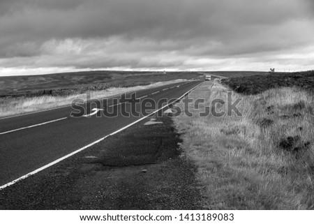 Bleak windswept moorland road image