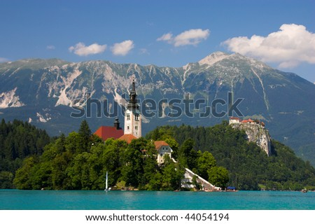 Bled lake, island, castle, church and mountains in background,Triglav, Slovenia, Europe