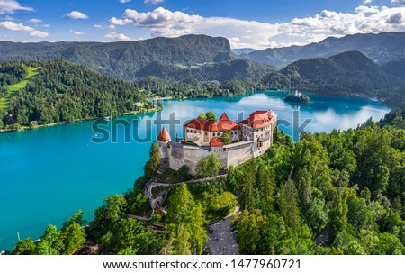 Bled, Slovenia - Aerial panoramic view of beautiful Bled Castle (Blejski Grad) with Lake Bled (Blejsko Jezero), the Church of the Assumption of Maria and Julian Alps at background on a nice summer day