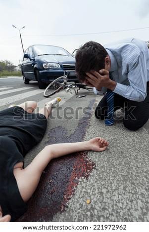 Bleeding woman on the pedestrian crossing, vertical