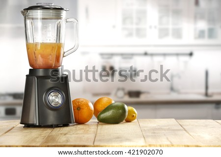 blender and fruits and kitchen space