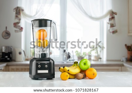 Blender and fruits on kitchen space