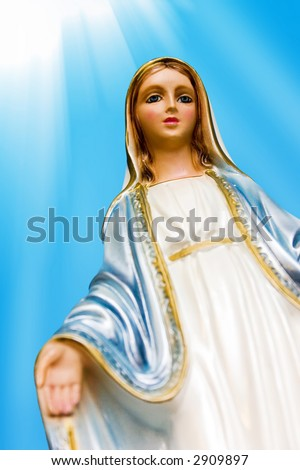 Blessed Virgin Mary. Mother Mary statue with rays of light.