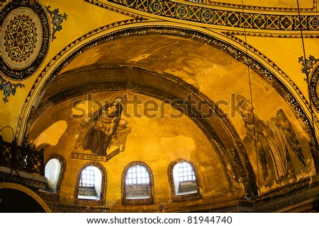 Blessed Virgin Mary with baby Jesus and Guardian Angel Byzantine art on the Hagia Sophia apse in Istanbul, Turkey