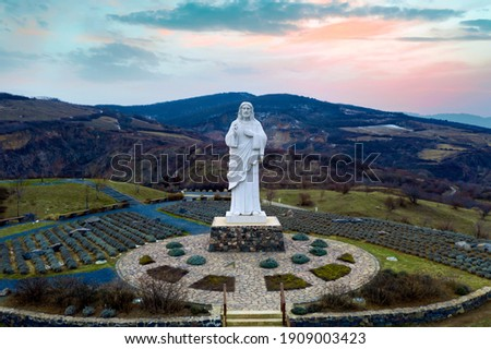 Blessing Jesus Christ monument in Tarcal Hungary. Giant religious statue next to Tarcal mine lake which same like than a tarn Stock fotó ©