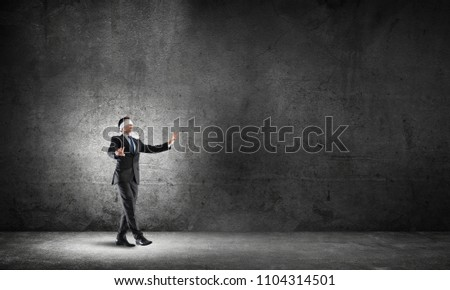 Blind businessman stepping carefully to find his way Stockfoto ©