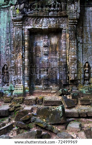 Blind doors to the ancient Buddhist temple in Angkor Wat complex, Cambodia, Siem Reap Province