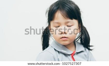 Blind little girl.Little girl close eyes.Blind person. #1027527307