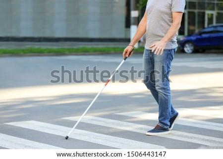 Blind mature man crossing road outdoors #1506443147