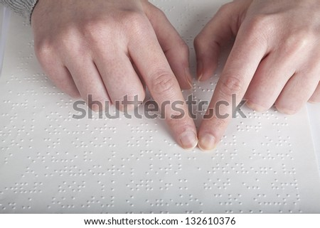 Blind reading text in braille language #132610376