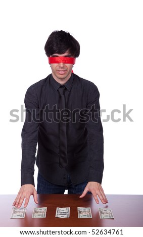 blindfold businessman trying to find his money (isolated on white)