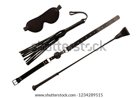 Blindfold mask, riding crop and ball gag, isolated on white background.