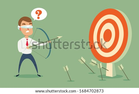 Blindfolded businessman shooting arrow. Missed the target. ストックフォト ©