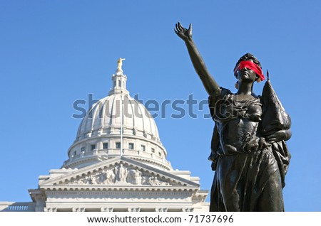 Blindfolded statue outside of Madison, Wisconsin Capitol building, symbolizing oppression.