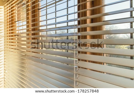 Blinds in a home catching the sunlight Stock photo ©