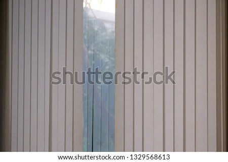 Blinds window decoration,Blinds window decoration of building with sunrise in morning, view of blind with glass surface with green trees background  that rising sun #1329568613